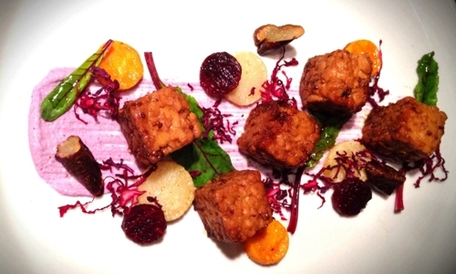 Roasted tempeh with roots, red cabbage sauce and c