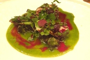 Snails under the grapevines, a dish that is a perfect summary of the origins and the destiny of Bottura's cuisine