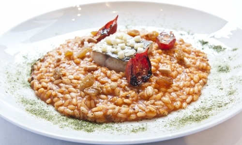 Il super-risotto di Apreda: risotto Riserva San Massimo mantecato conpassata di pomodoro bio Oilalà