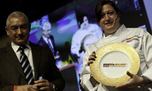 Manfredi Barbera, owner of Premiati Oleifici Barbera, awards Missy Robbins