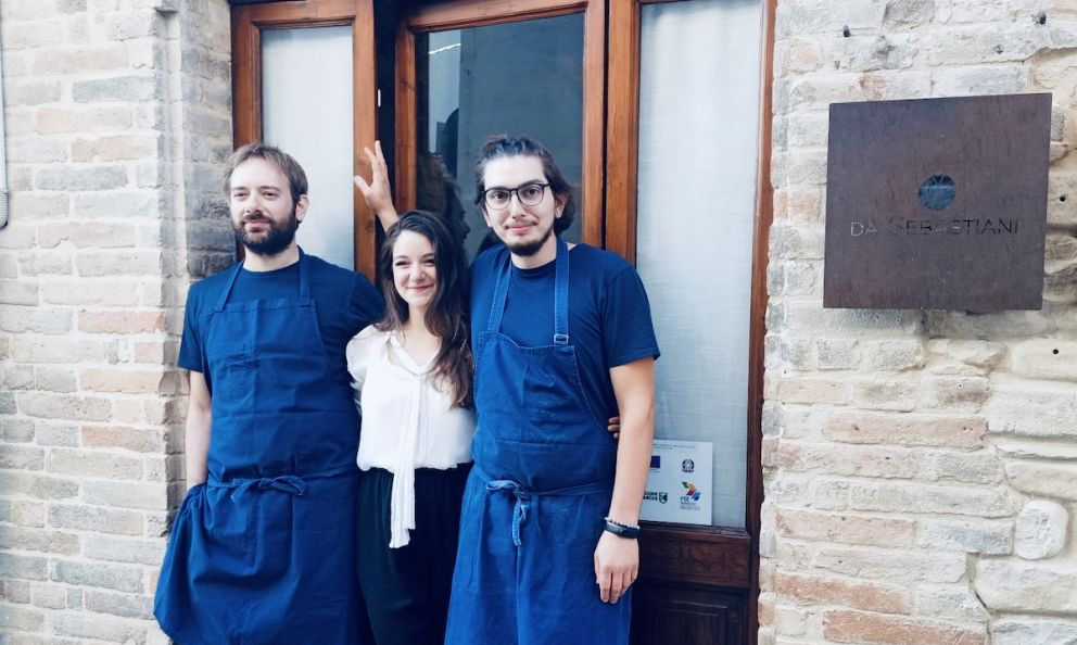 Carlo Sebastiani,Alice VannicolaandMaicol Pasqualiin front of the entrance of restaurant da Sebastianiin Ortezzano, in the province of Fermo, opened on the 2nd of June 2021