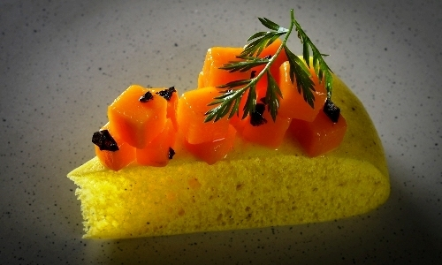 Indian steamed focaccia with yellow pumpkin and bl