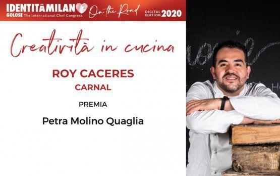 PetraMolino Quagliapremia Roy Caceres, del ristorante Carnal di Roma,col premio Creatività in Cucina