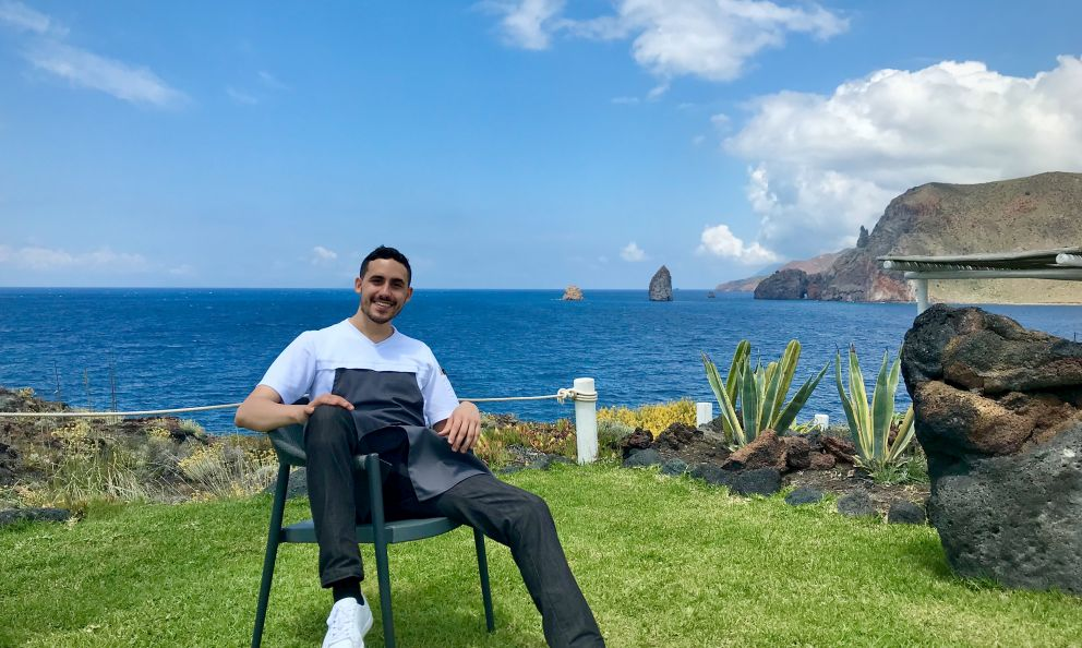 Davide Guidararelaxing on the grass at his vegetarian restaurant I Tenerumi, inside the Therasia Resortin Vulcano, Aeolian islands, Sicily. All the photos are from Tanio Liotta