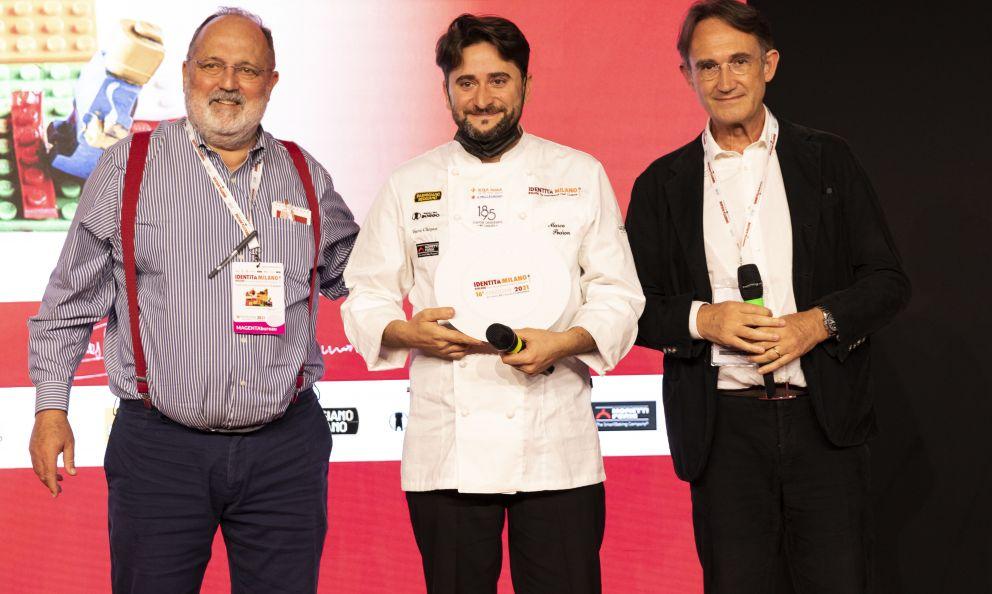 PetraMolino Quagliapremia Marco Pedron, del ristorante Cracco in Galleriadi Milano,col premio Creatività in Cucina