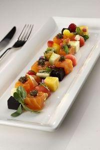 Mosaico di frutta e pesce