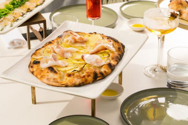 Pizza withPotatoes, guanciale and fennel seedsbyFrancesco ApredaatDivinityin Rome (photoAlberto Blasetti)