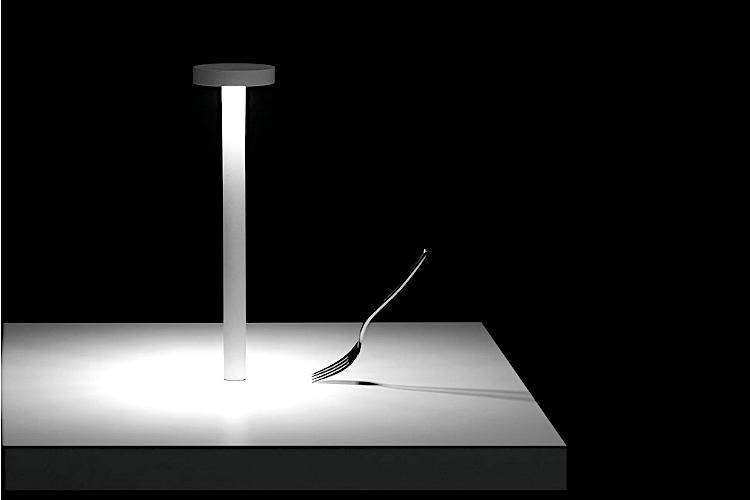 Tetatet (2013) by Davide Groppi, a lamp that revolutionised the concept of light in restaurants. «A portable lamp to transform every table in a place of meeting and love, and consider light, at last, as an essential ingredient in life. It's the most beautiful light in the world. It makes everything deeper and more real. It's the light that makes us feel unique around a table»