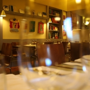 The dining room of Timè seen through a glass