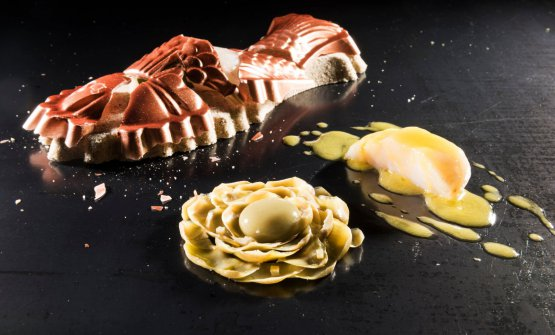 Il pesce in crosta di sale e mannitolo, con ninfea di carciofo,crema dello stesso ortaggio, sferificata, pil pil di acqua di vongole e trippe di pesce cotte in olio