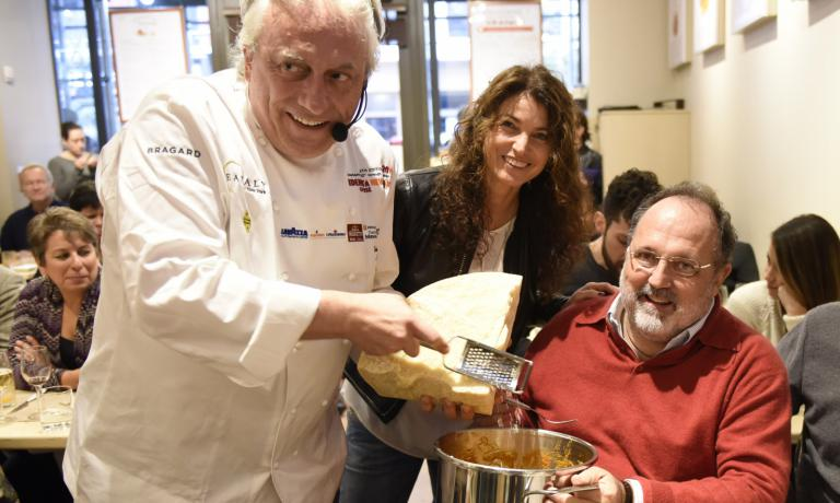 Scabin serving Amatriciana right from the pressure cooker with Elisabetta Serraiotto of Grana Padano and Paolo Marchi of Identità Golose