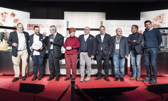 Un'anticipazione della Giuria dell'ottava edizione, sul palco di Identità Milano 2018. La prossima finale si terrà proprio durante il Congresso milanese nel 2019 (foto Brambilla/Serrani)