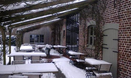The snowy exterior of the In De Wulf restaurant, i