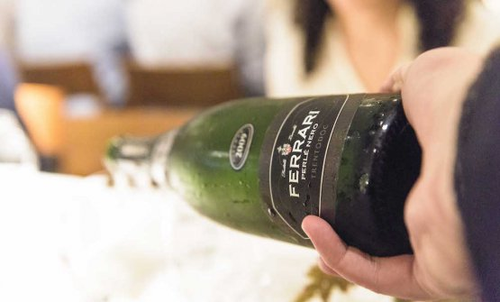In the glasses, bubbles by Cantine Ferrari