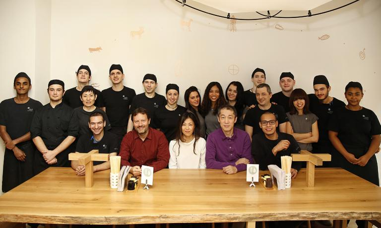 Brendan Becht (the seated man with a beard) with the staff at Zazà Ramen (photo by Matteo Barro)