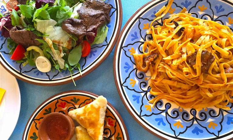 Lagman pasta, horse salad, a small dish with basturma echeburek: a very enjoyable meal at the Kazak restaurant