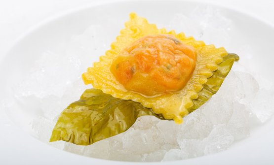 Raviolo stuffed with salmon Ora King in a vegetable broth