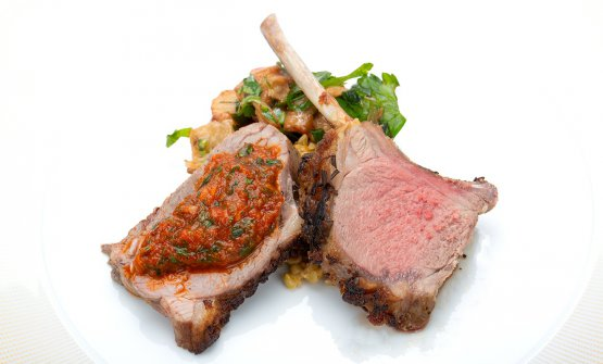 Te Mana roasted lamb with Aleppo chilli pepper, aubergine with mint and cumin relish, harissa, and freekeh green wheat