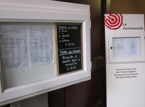 I men� esposti dallo chef Christian Milone all'ingresso della Trattortia Zappatori e della novit� degli ultimi mesi, la Gastronavicella, al 34 di Corso Torino a Pinerolo in Piemonte. Info e prenotazioni al +39.0121.374158, e-mail christian.miloneehcn@alice.it, purtroppo non esiste ancora un sito