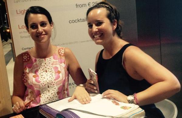 Anna Rivaletto, autrice dell'articolo, e Chiara Nicolini al desk dell'accoglienza di Identità Expo