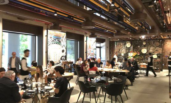 The dining room atCondividere, the restaurant created byLavazzain their new headquarters in Torino