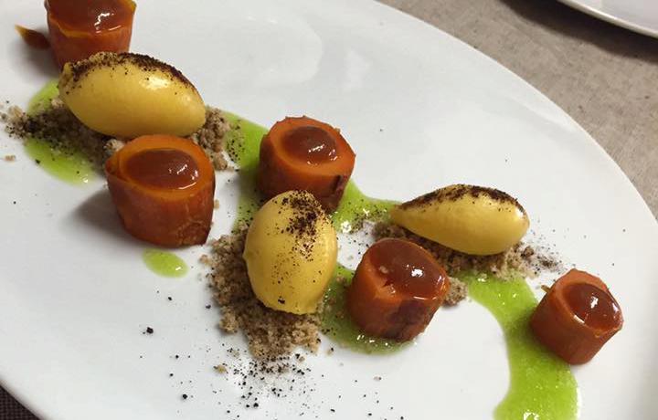 Carota al miso, camomilla selvatica, frutto della passione e liquirizia, dessert de La Tana Gourmet