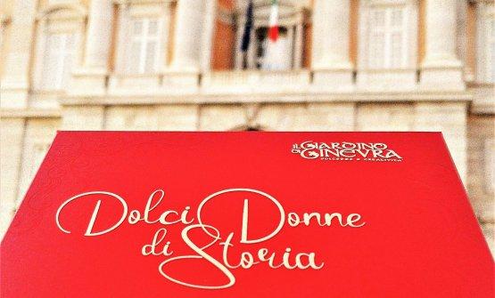 Sullo sfondo la Reggia di Caserta. In primo piano la confezione che racchiude il nuovo progetto, tra storie di donne e grande cioccolato, della pasticciera Anna Chiavazzo