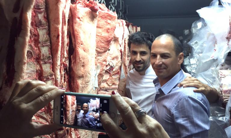 A close up of Pablo Rivero, patron at Don Julio in Buenos Aires. Behind him, chef Guido Tassi who also contributes to the success of this excellent chargrilled meat restaurant