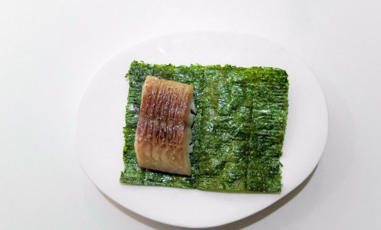 We leave the table and move to the counter overlooking the kitchen. Here they serve two tastings ofCocina de producto. The first is the marvellousTacos of smoked eel and seaweed