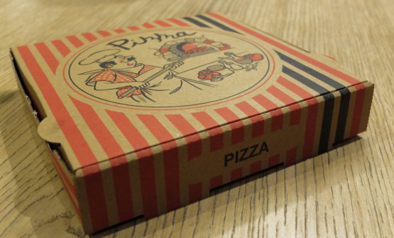 A pizza carton box is served...