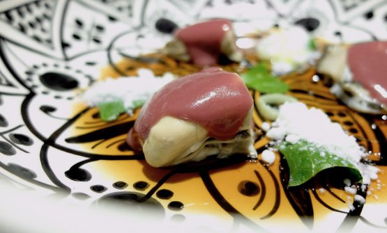 Oysters with juice of Kalamata olives, kefir snow and lamb gelatine