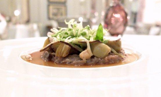 Squisita l'Insalata di testina di maiale con carciofi, porcini, sedano ed erbe (si sente bene la menta), con condimento alle nocciole e olio alle cipolle e prezzemolo
