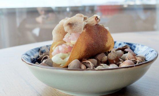 Tacos con ricciola, nocciole e tartufo bianco