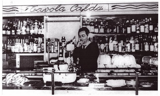 A very young Marchesiat the counter of Mercato, the family hotel-cum-restaurant