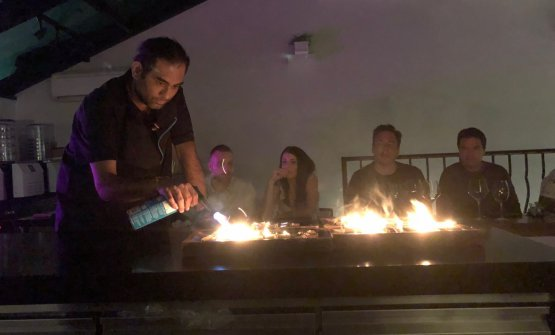 Using a torch, Gaggan Anand burns banana leaves.