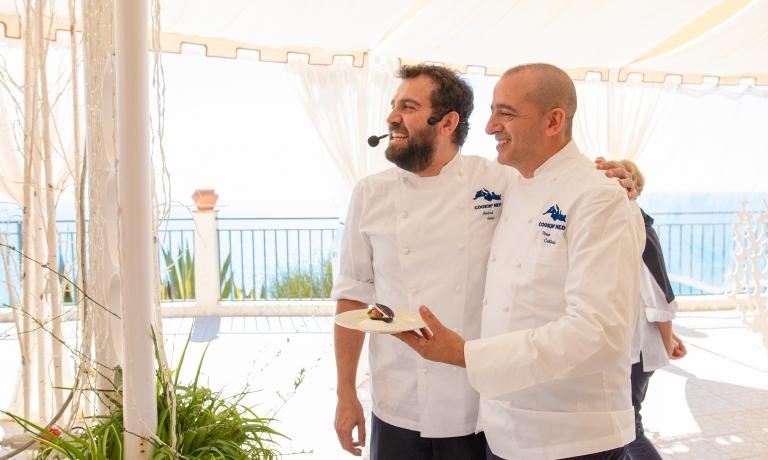 Il turcoMaksut Askarcon Pino Cuttaia, organizzatore di Cookin'Med. Le foto sono di Ciccio Monte