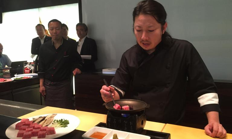 Chef Hide Shinohara of the Zero contemporary food in Milan, at work yesterday with wagyū beef