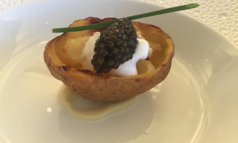 Steamed jacked potato with caviar