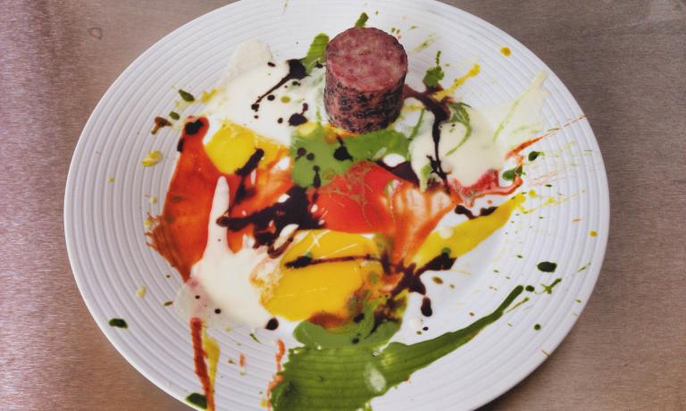 Beautiful Sonic Disco of Love and Hate at the Gate of Hell Painting with Wicked Pools of Glorious Color and Psychedelic Spin-painted Cotechino, not Flame Grilled: this dish was born thanks to the friendship between Massimo Bottura and British artist Damien Hirst