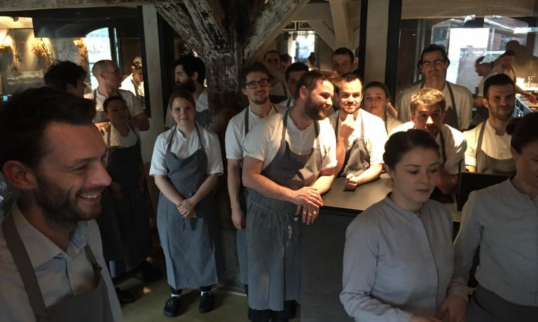 The traditional welcome given by the cooks at Noma, a trademark for the establishment that was number one in the World's 50 Best 4 times (in 2010, 2011, 2012 and 2014). In the centre, Riccardo Canella
