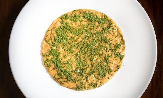 Risotto al brodo di manzo, ricci, kombu e cime di rapa