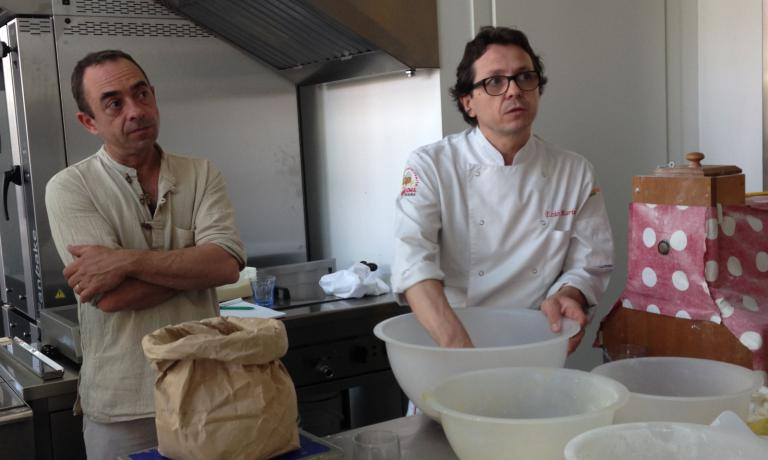 Enzo Marinato at work with the panettone dough, under the observation of his Breton colleague