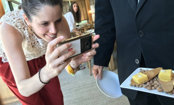 A Spanish journalist takes photos of the formidable tapas during the event dedicated to the excellent Joselito: Chorizo marshmallows and corn