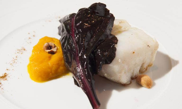 Cod with pumpkin cream and hazelnuts