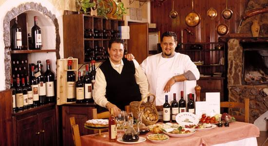 The two managers of restaurant La Pitraia, specialised in mushrooms and game