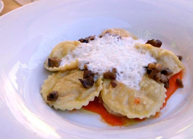 One of Caterina Ceraudo's dishes: Ravioli with squid ink, mousse of buffalo milk mozzarella and aubergine chips and cream of raw tomato