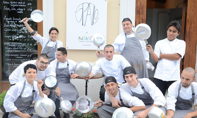 The kitchen staff of the first Spazio restaurant in Rivisondoli (L'Aquila), in the previous location of restaurant Reale