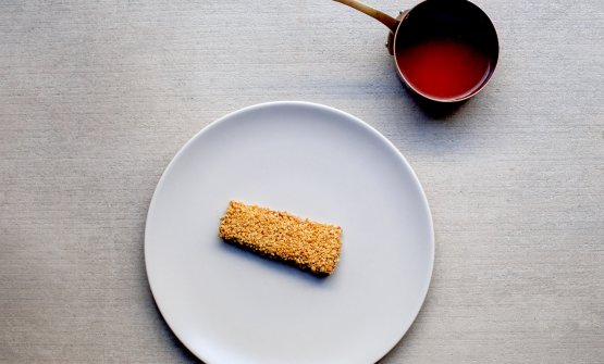 Preparing the garfish filet with tomato jus made from the scraps of the marinating juice prepared for the same filet