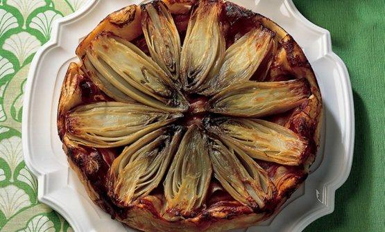 Una delle numerose versioni della Tarte Tatin, in questo caso alla indivia belga e bacon