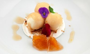White chocolate semifreddo spheres with Birra Moretti La Rossa gelatine over an orange marmalade with ginger, lemon and hop, a dish presented by Francesco Ferrari, chef at restaurant Le Scuderie in Relais Falisco in Civita Castellana (Viterbo), on the occasion of Premio Birra Moretti Grand Cru 2013